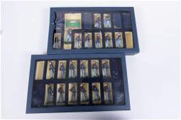 Two Boxes of Miniature Cast Metal Soldiers
