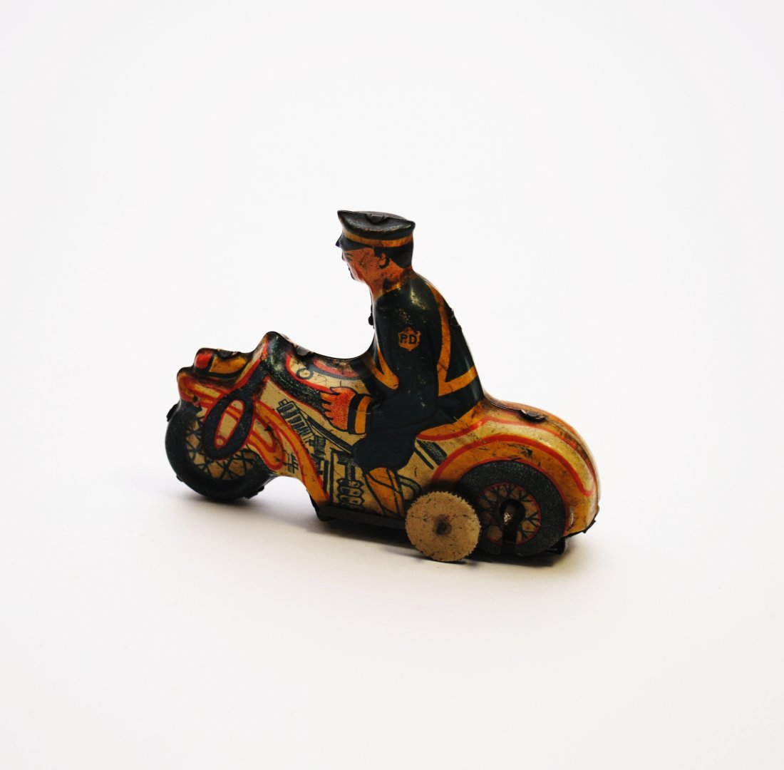 Vintage Wind-up Tin Toy Policeman on Motorcycle