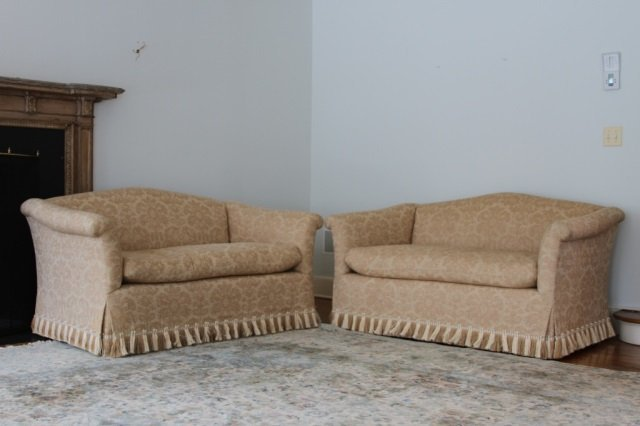 PAIR OF UPHOLSTERED SETTEES