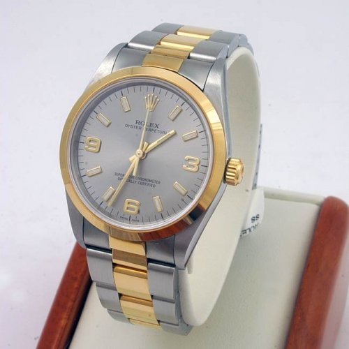 ROLEX OYSTER PERPETUAL STAINLESS STEEL AND 18K YELLOW