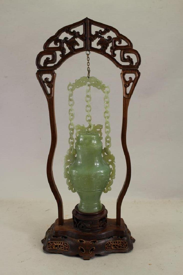 Chinese Jade Vase in Reticulated Wooden Stand