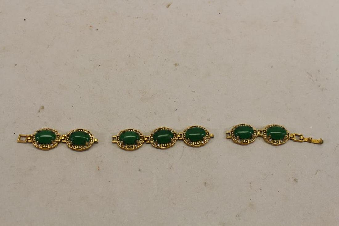 Gold Tone Bracelet with Green Inset Stones