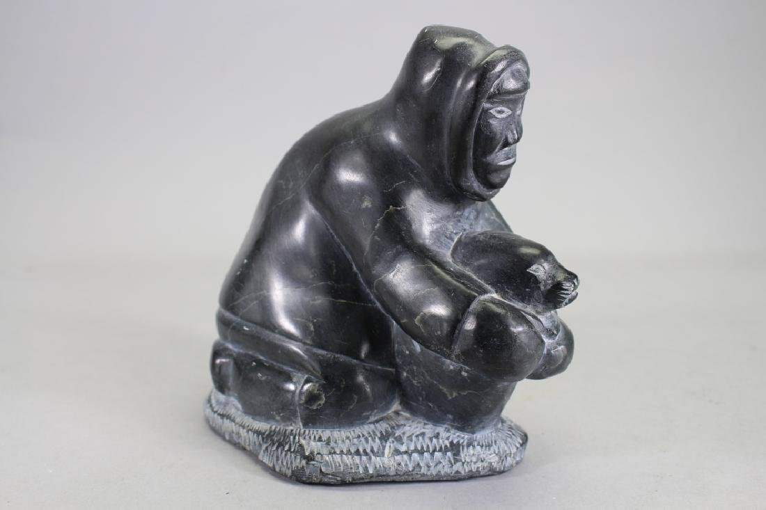 Carved Sculpture of Inuit Hunter Capturing Seal
