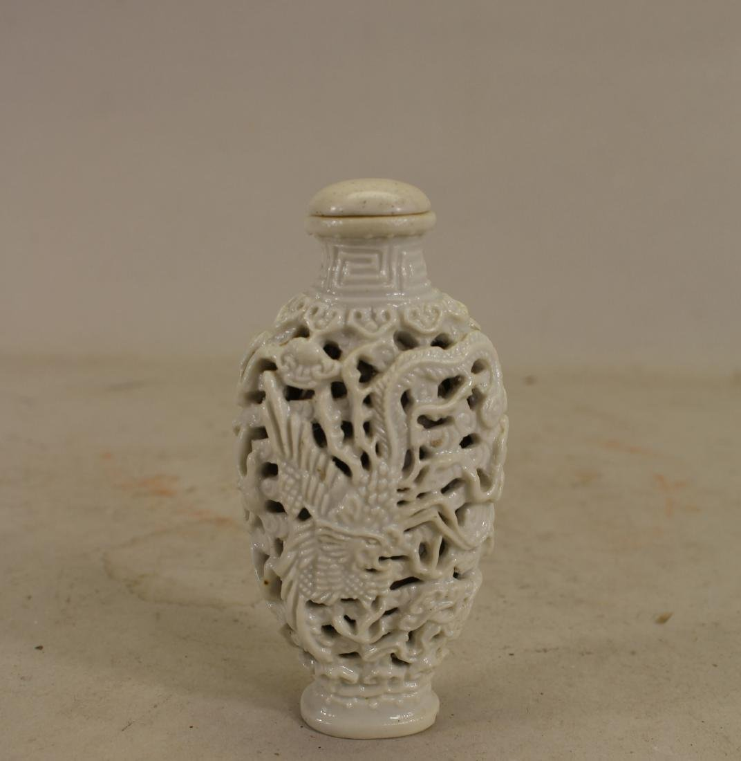 Chinese Reticulated Porcelain Dragon Snuff Bottle