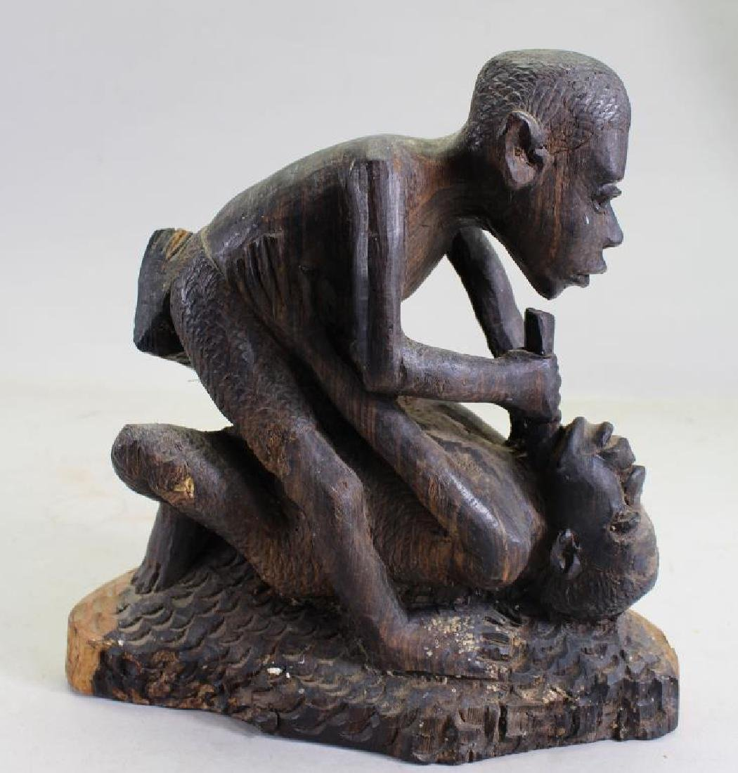 African Wood Carved Fighting Sculpture