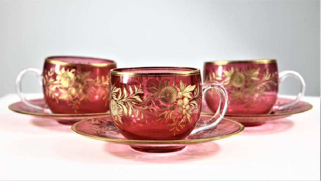 Three (3) cranberry cups and saucers, Moser-type