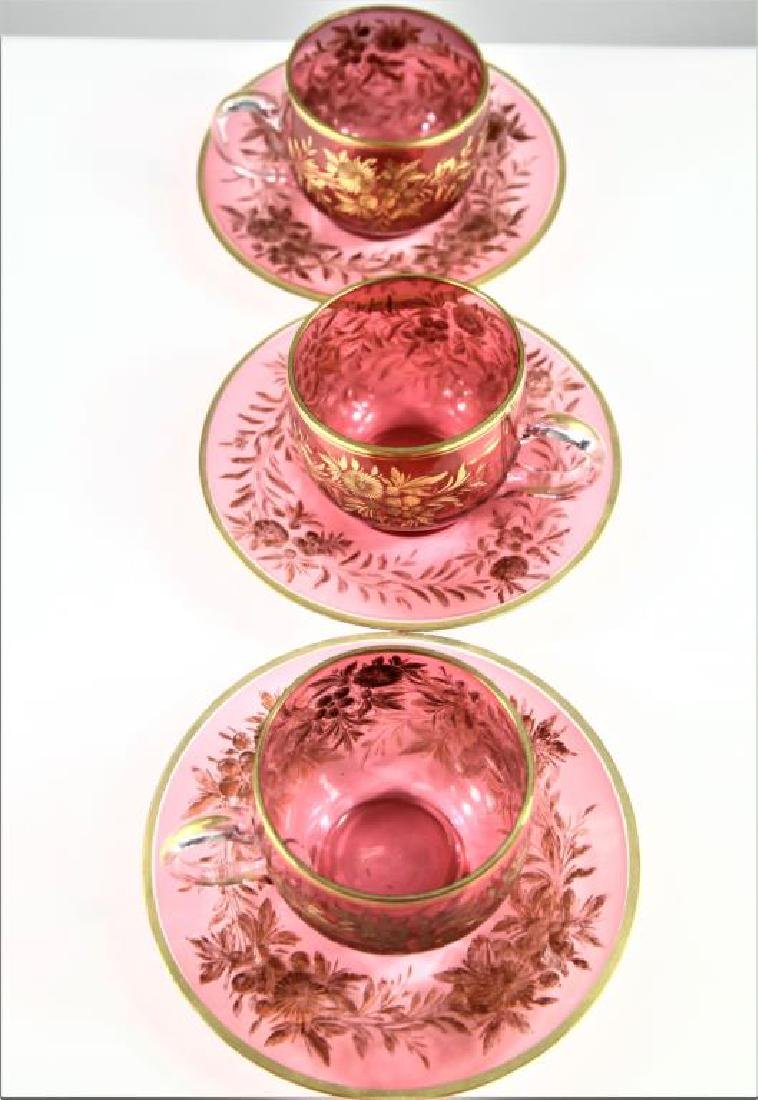 Three (3) cranberry cups and saucers, Moser-type - 6