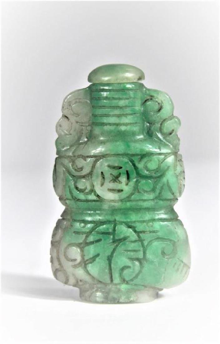 Carved Green Stone Snuff Bottle