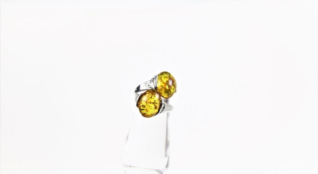 Pair of Yellow stone rings
