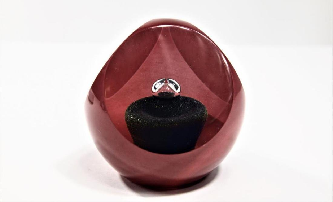 Correia plum-colored paperweight