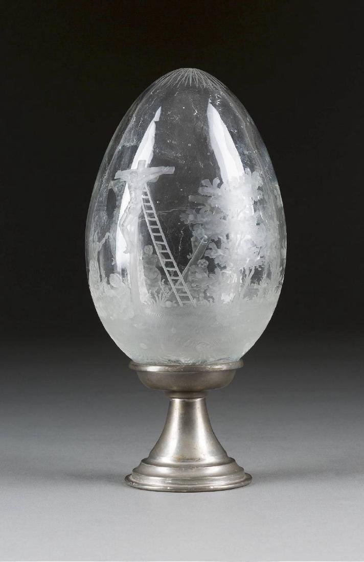 A LARGE GLASS EGG SHOWING THE CRUCIFIXION Probably