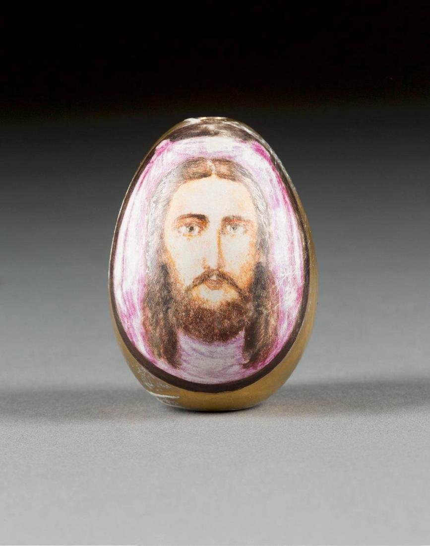 A PORCELAIN EASTER EGG SHOWING THE MANDYLION Russian,