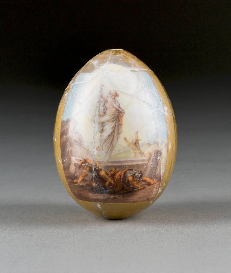A LARGE PORCELAIN EASTER EGG SHOWING THE RESURRECTION