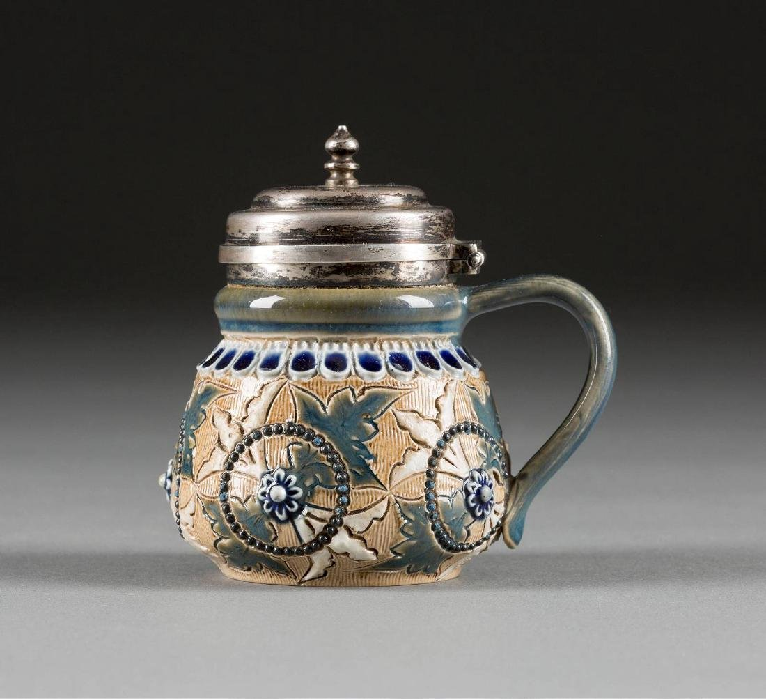 A SMALL CERAMIC SILVER-MOUNTED MUSTARD POT England,