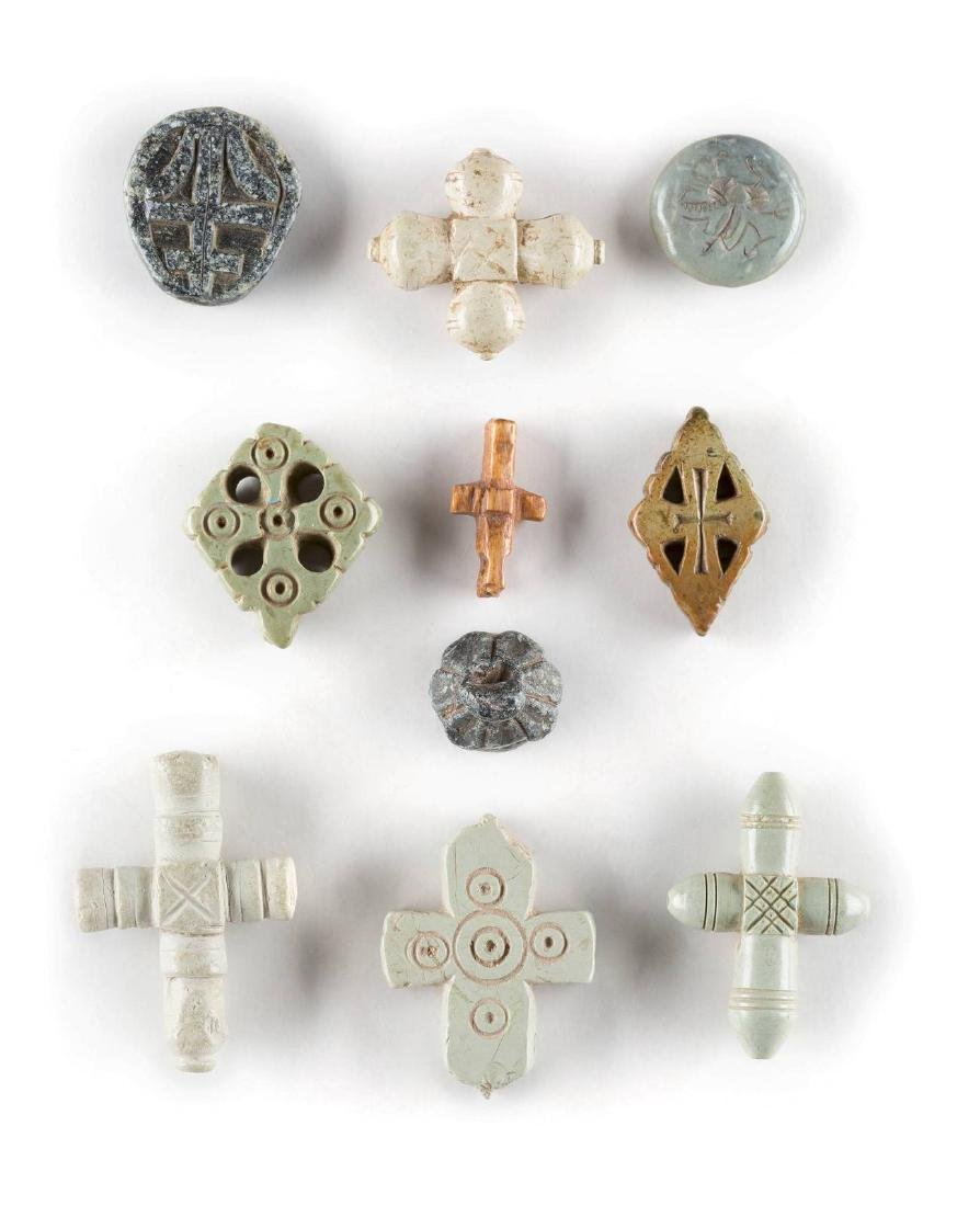 A COLLECTION OF SEVEN STEATITE CROSSES AND THREE SEALS