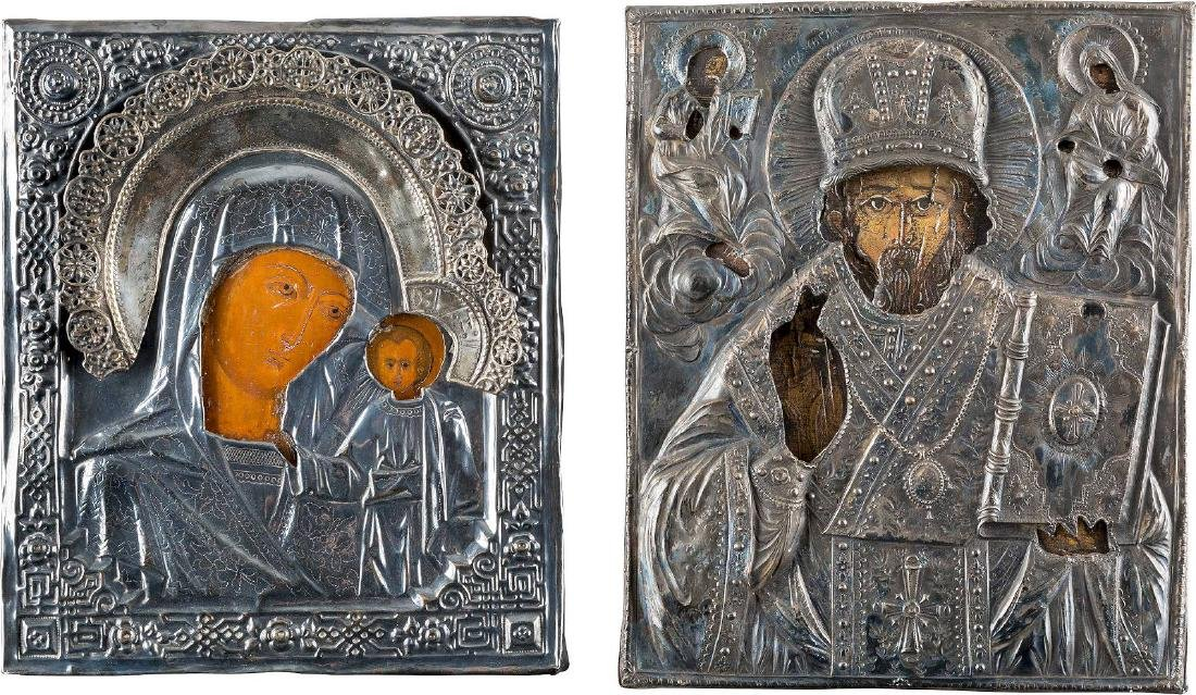 TWO ICONS WITH OKLAD SHOWING ST. NICHOLAS OF MYRA AND