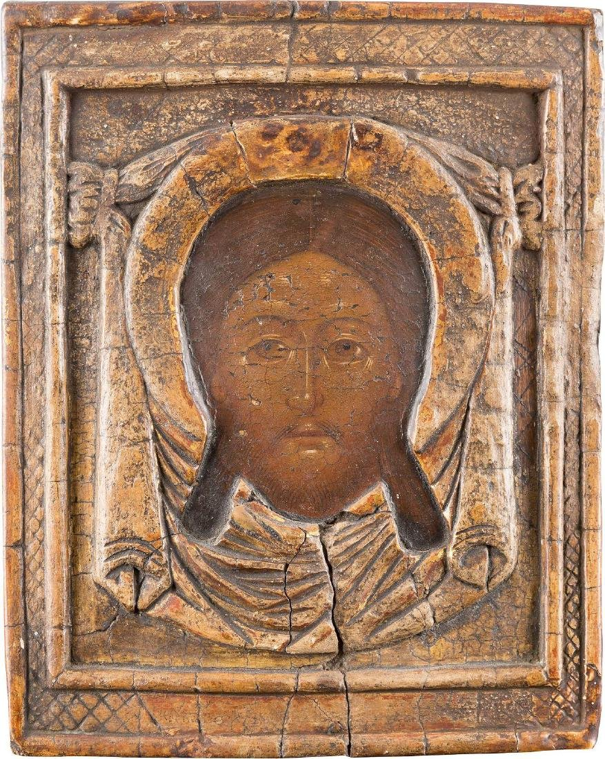 A RARE ICON SHOWING THE MANDYLION WITH CARVED OKLAD