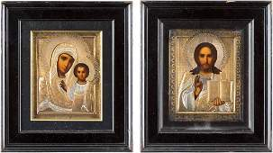 A PAIR OF WEDDING ICONS WITH SILVER PARCELGILT OKLADS