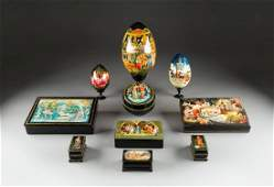 A GROUP OF TEN PAPIERMACH AND LACQUER BOXES AND EGGS