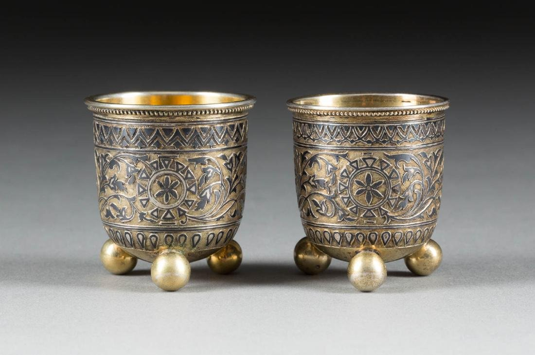 A PAIR OF SILVER-GILT AND NIELLO BEAKERS Russian,