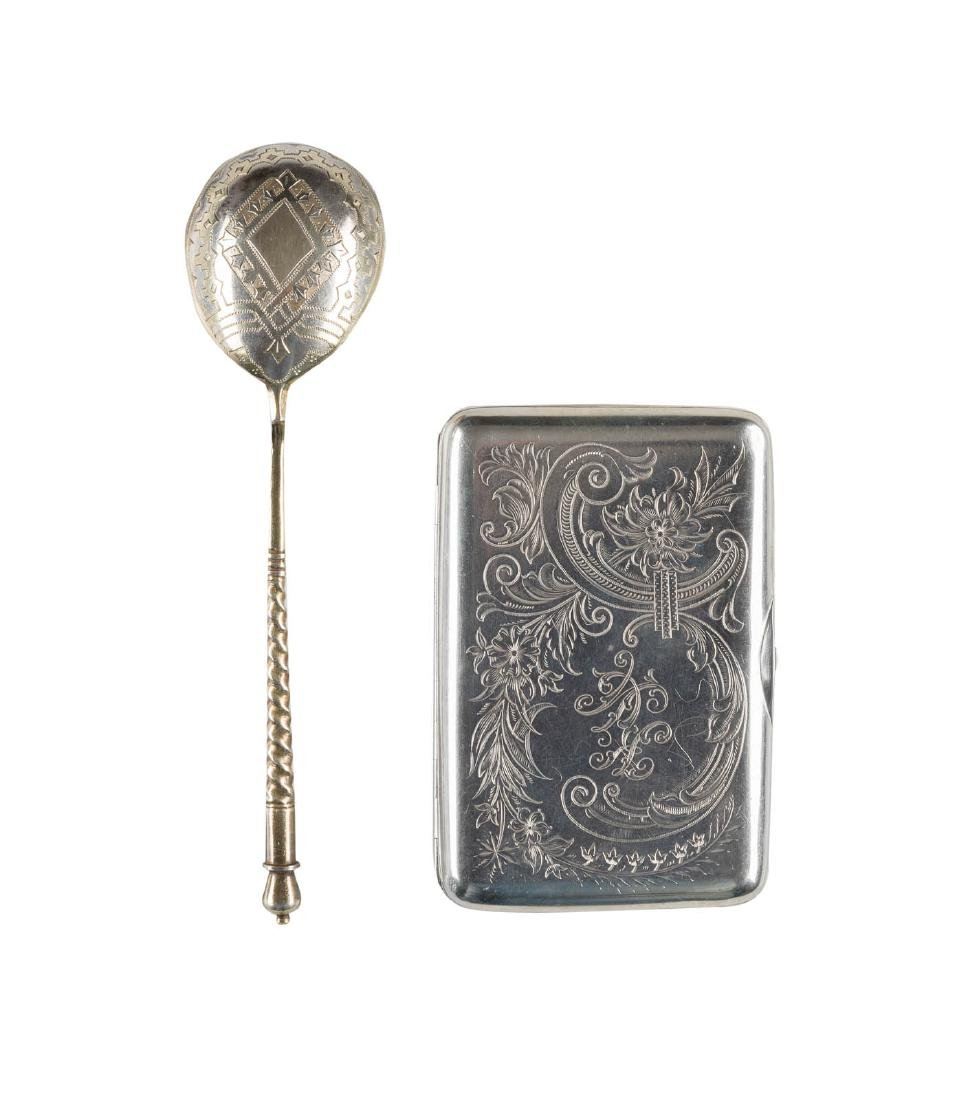 A SILVER CIGARETTE CASE AND A LARGE SILVER PARCEL-GILT