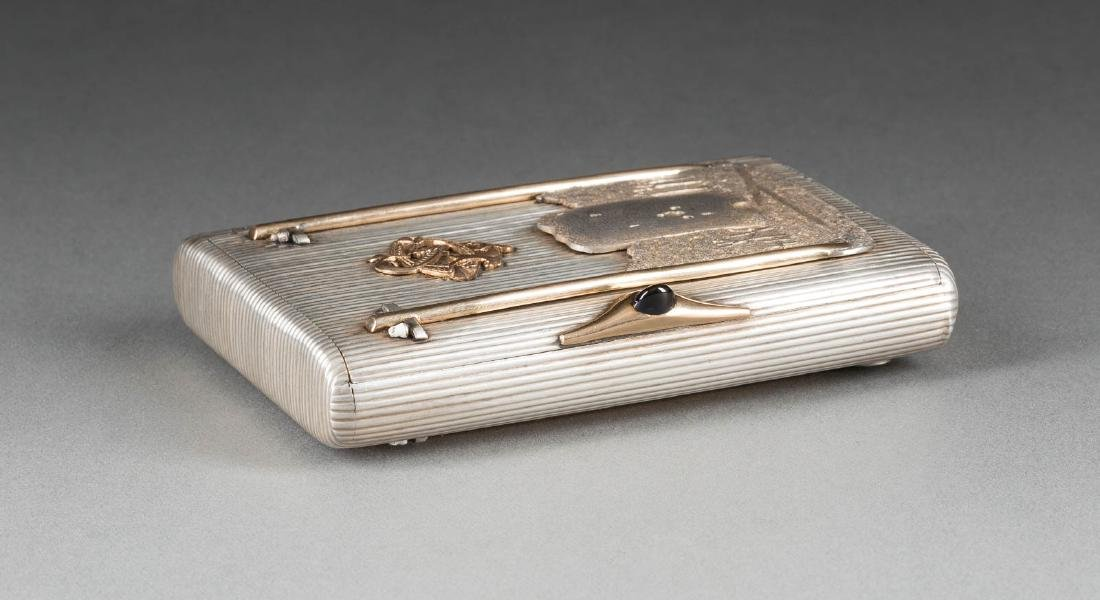 A 1913 DATED SILVER CIGARETTE CASE SHOWING AN