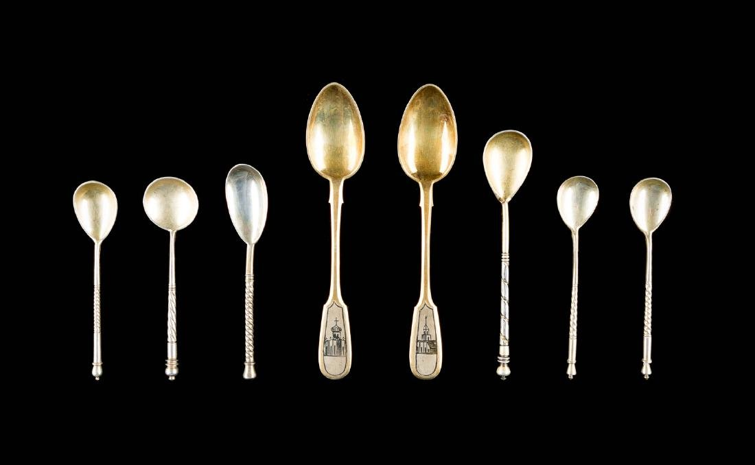 EIGHT SILVER AND NIELLO SPOONS WITH ARCHITECTURAL VIEWS