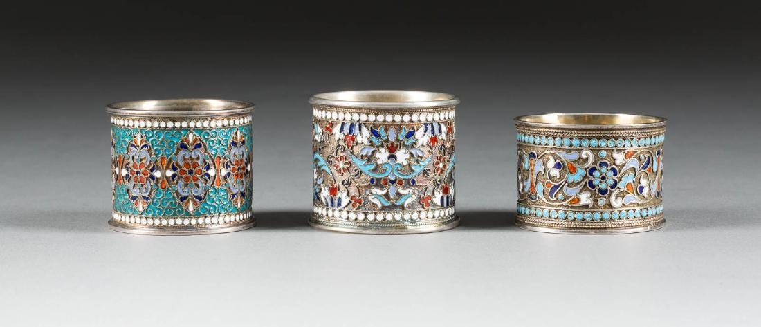 THREE SILVER AND CLOISONNÉ ENAMEL NAPKIN HOLDERS