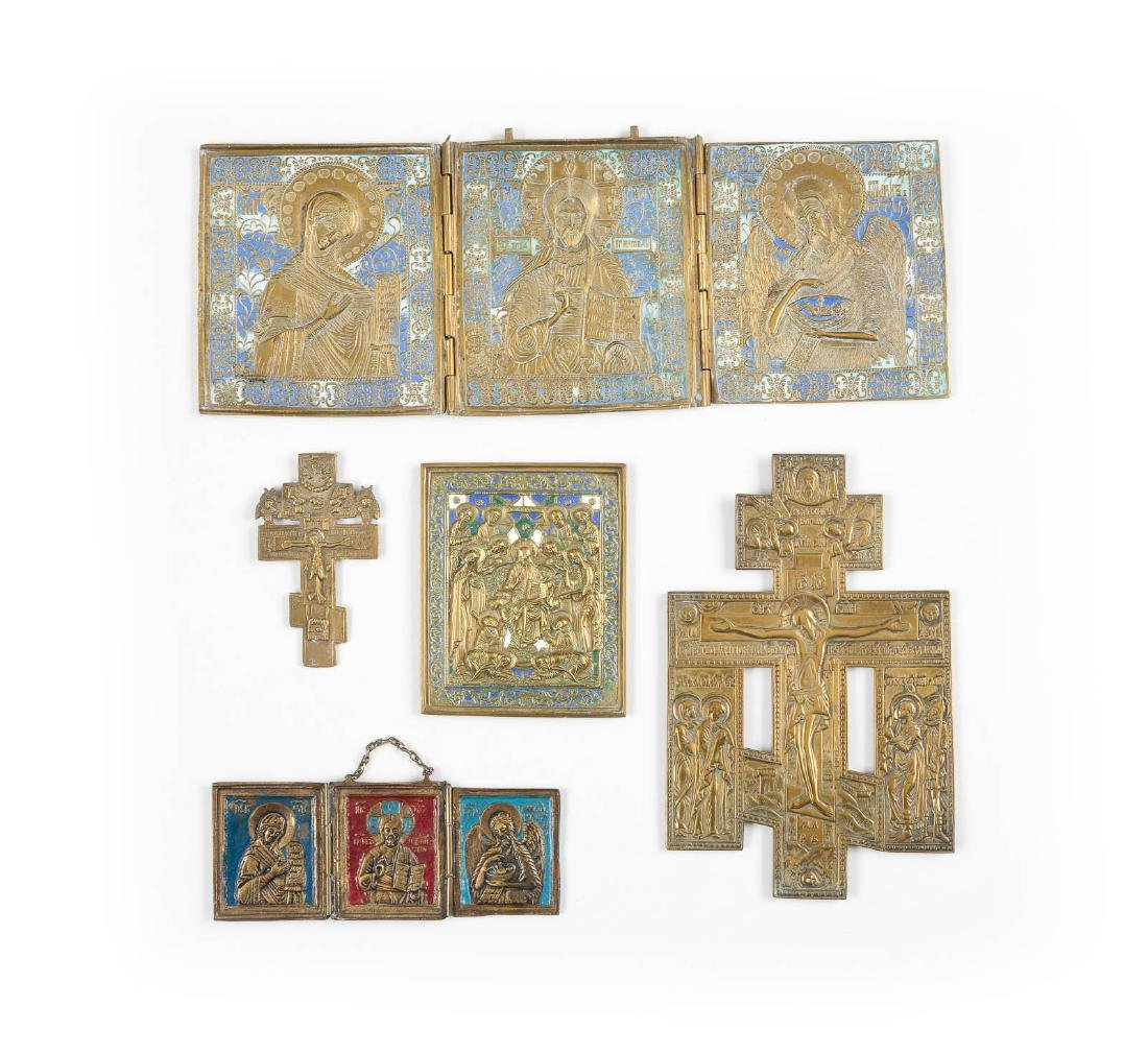 TWO TRIPTYCHS, TWO CRUCIFIXES AND A BRASS ICON SHOWING
