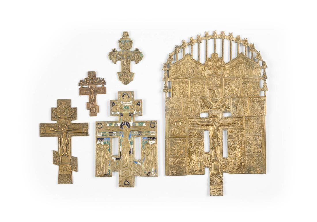 A COLLECTION OF FIVE BRASS CRUCIFIXES Russian, 19th