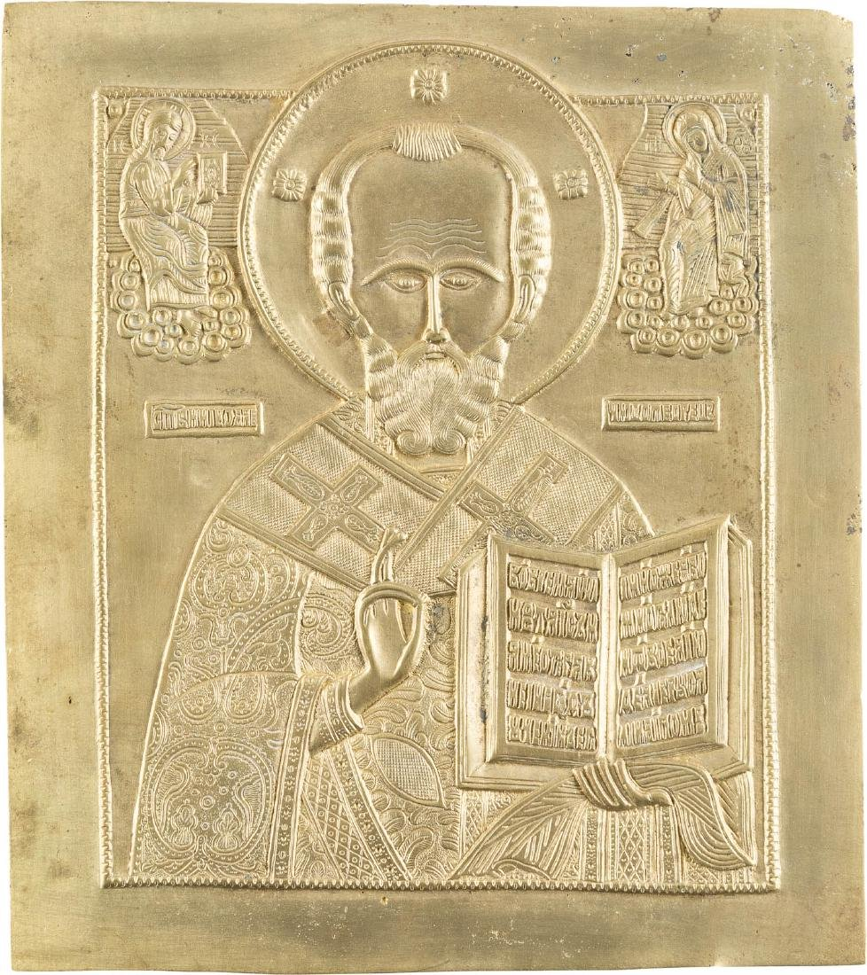 A LARGE BRASS ICON SHOWING ST. NICHOLAS OF MYRA