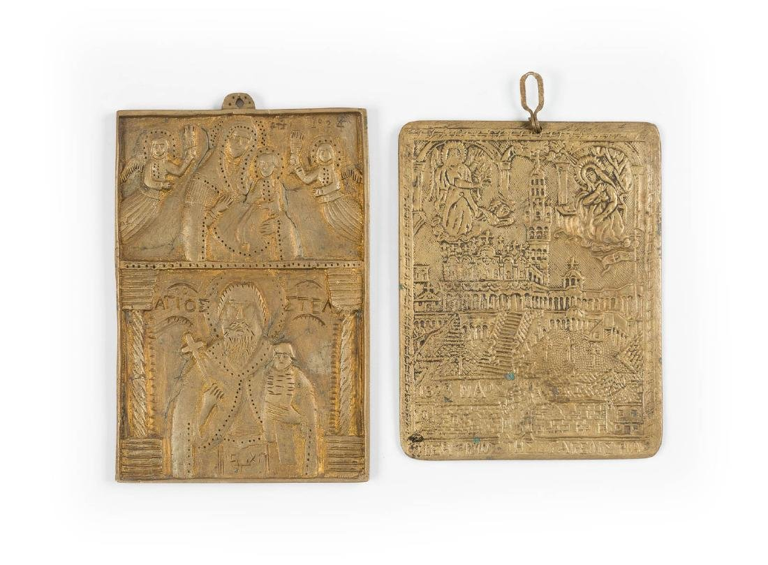 TWO BRASS PLAQUES SHOWING ANNUNCIATION AND MOTHER OF