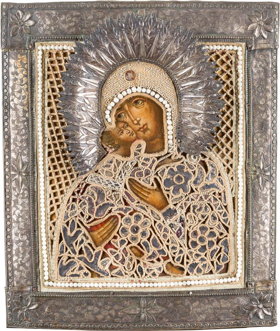 AN ICON SHOWING THE VLADIMIRSKAYA MOTHER OF GOD WITH AN