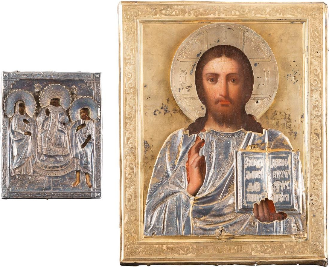 TWO ICONS WITH SILVER PARCEL-GILT OKLAD SHOWING A