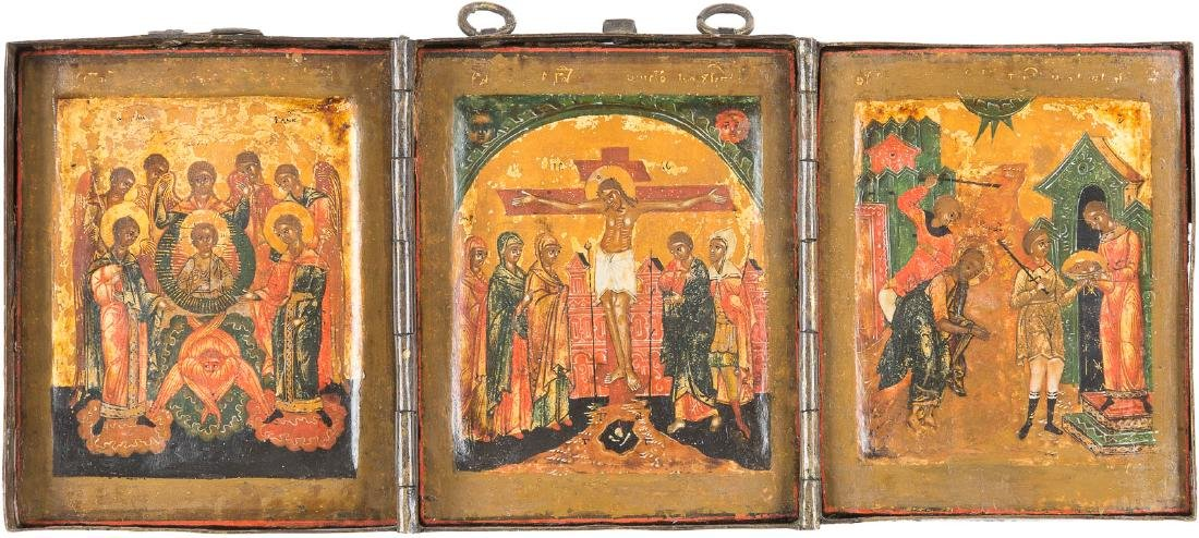 A SMALL TRIPTYCH SHOWING THE CRUCIFIXION, THE SYNAXIS