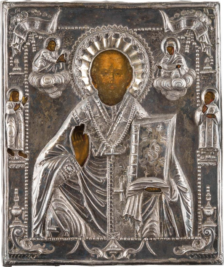 A SMALL ICON SHOWING ST. NICHOLAS OF MYRA WITH SILVER