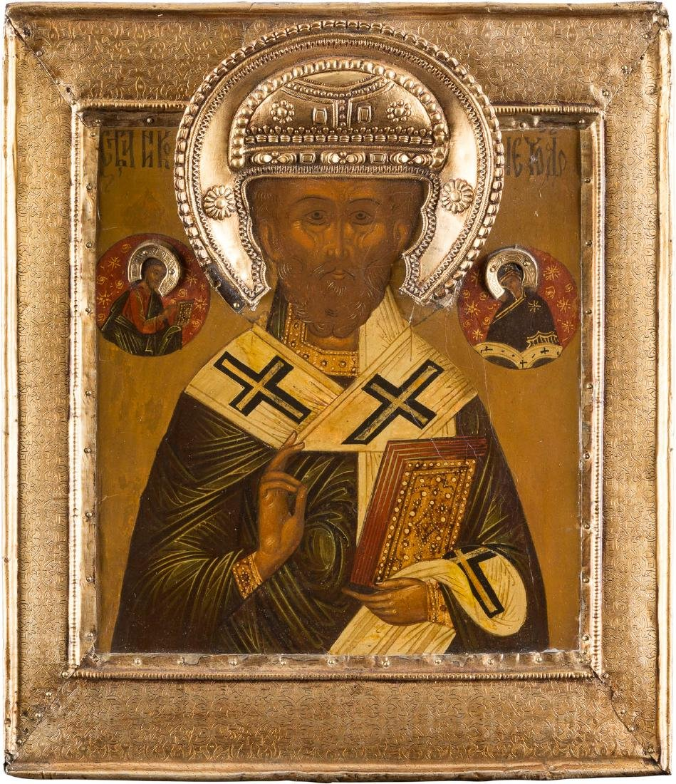 AN ICON SHOWING ST. NICHOLAS OF MYRA WITH A SILVER-GILT