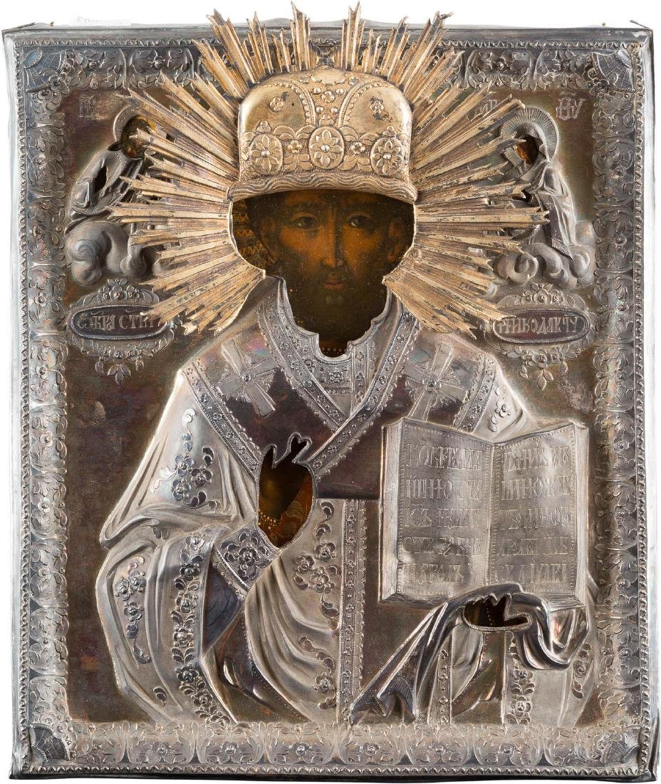 AN ICON SHOWING ST. NICHOLAS OF MYRA WITH A SILVER