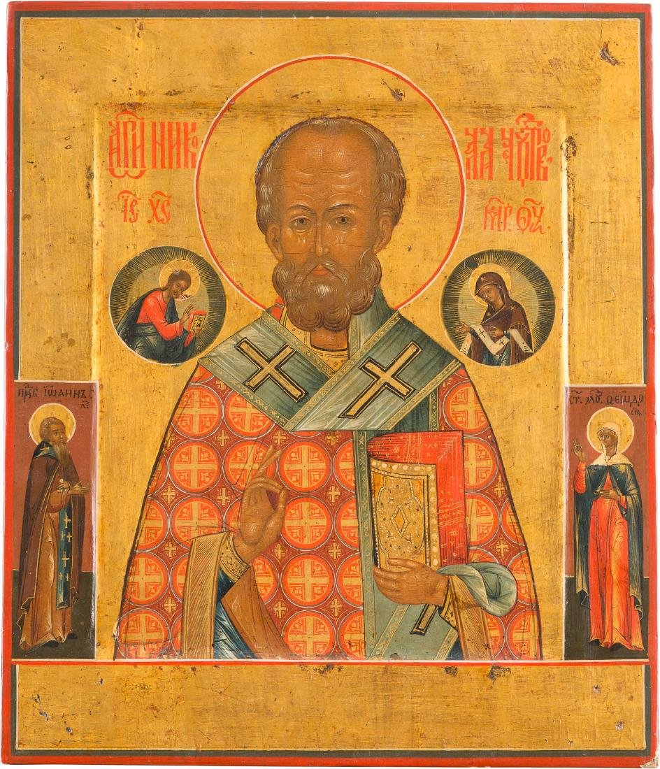 A LARGE ICON SHOWING ST. NICHOLAS AND TWO SAINTS