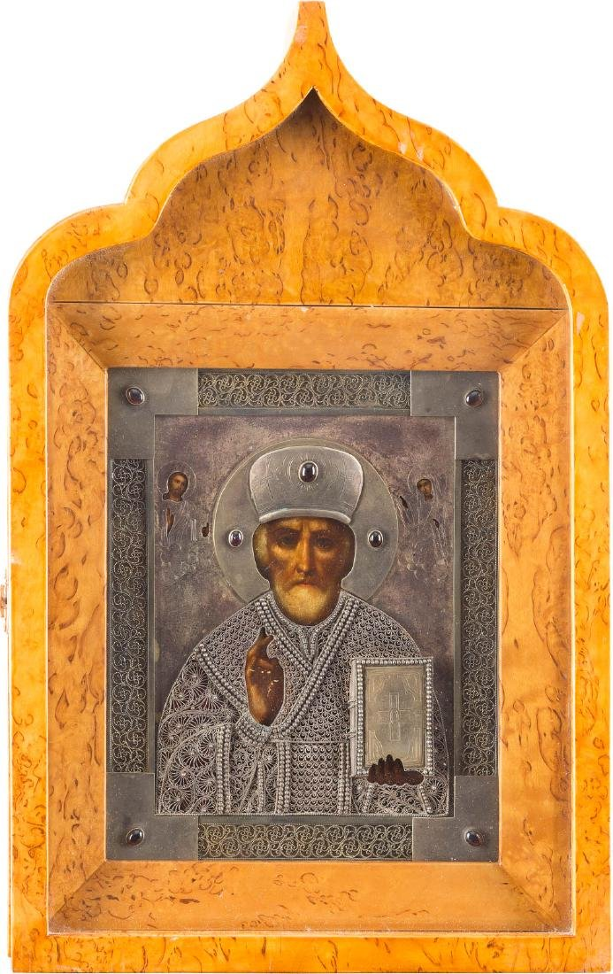 A GEM-SET SILVER-MOUNTED ICON OF ST. NICHOLAS THE