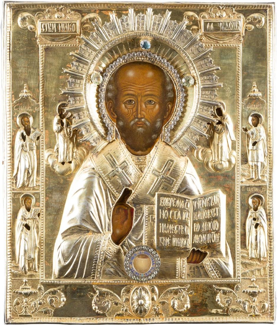 A RARE ICON SHOWING ST. NICHOLAS OF MYRA WITH A