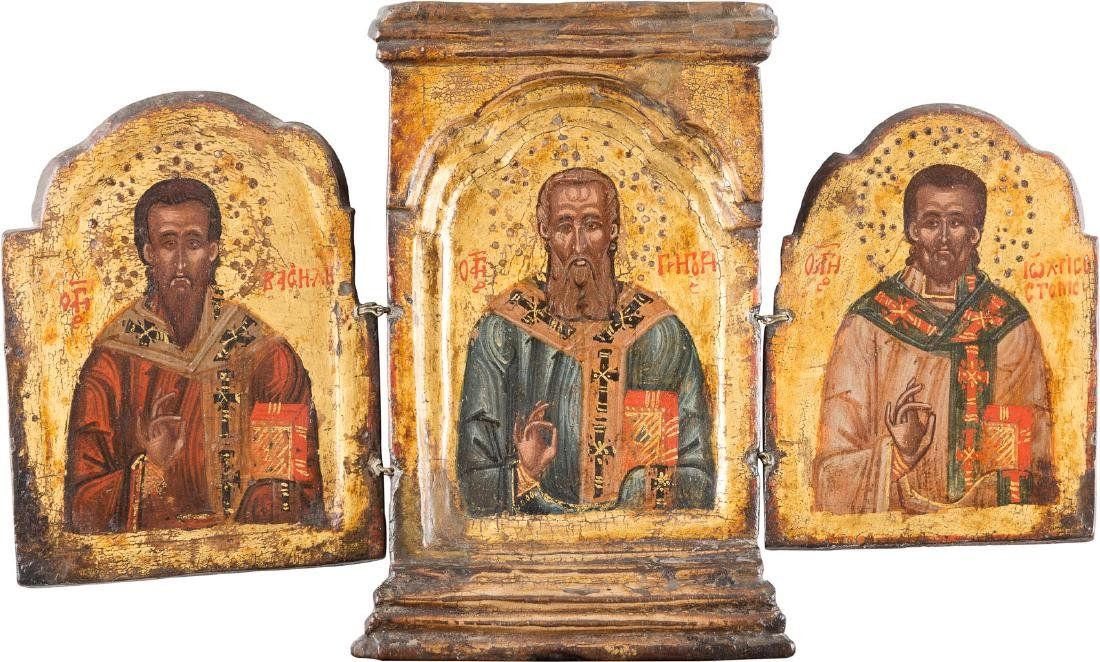A SMALL TRIPTYCH SHOWING THREE BISHOP SAINTS Greek,