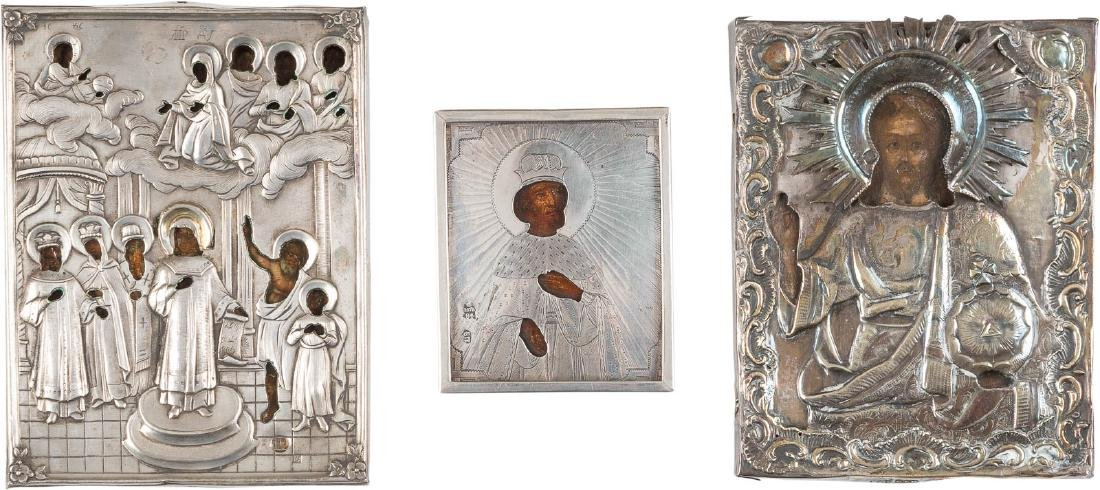 THREE MINIATURE ICONS WITH SILVER OKLAD SHOWING THE