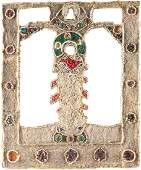 AN EMBROIDERED OKLAD OF AN ICON SHOWING THE MOTHER OF