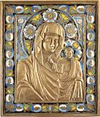 A LARGE BRASS AND ENAMEL ICON SHOWING THE MOTHER OF GOD