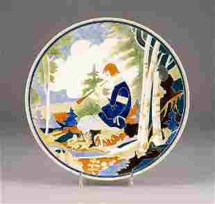 A LARGE FAIENCE PLATE SHOWING A BOY PLAYING THE FLUTE