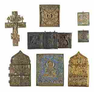 A TRIPTYCH SHOWING DEISIS, A CRUCIFIX AND EIGHT BRASS
