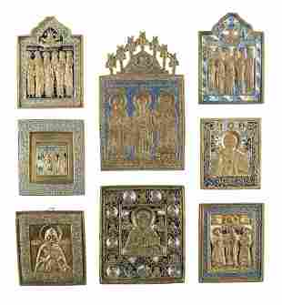 A COLLECTION OF EIGHT BRASS ICONS SHOWING SELECTED