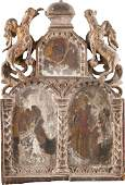 A SMALL ICON SHOWING TWO SAINTS IN BISHOP'S ATTIRE AND