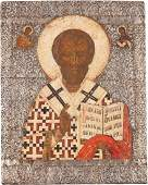 A LARGE ICON SHOWING ST. NICHOLAS OF MYRA WITH SILVER